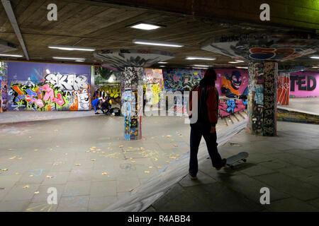 Skaters at night  in the Undercroft skate park, The South Bank, London, England - Stock Image