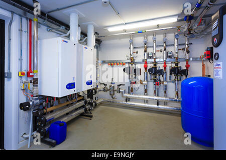Small boiler room servicing  a small school - Stock Image
