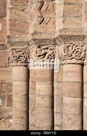 Leominster Priory, UK. The 12c west doorway has elaborately carved Romanesque capitals by the local Herefordshire School of sculptors. - Stock Image