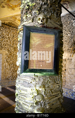 Walls and column decorated with human remains in the Chapel of Bones, Church of St Francis, Evora, Alentejo, Portugal, - Stock Image