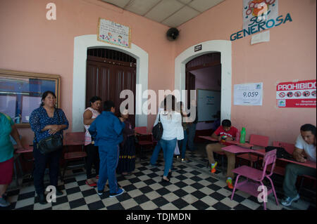 June 16, 2019 - Quetzaltenango, Quetzaltenango, Guatemala - Voters wait in a line to vote at a polling station during the first round of presidential election in Quetzaltenango in Guatemala June 16, 2019. (Credit Image: © Hiroko Tanaka/ZUMA Wire) - Stock Image