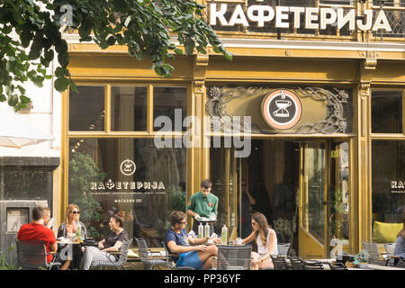 People chatting at the Kafeteria - local cafe chain in Belgrade, Serbia. - Stock Image