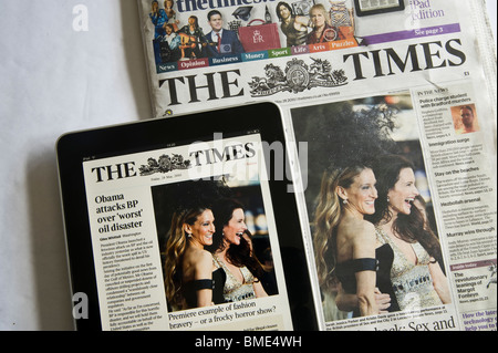 The Times Newspaper and the ipad online edition. Murdoch is hoping to make money charging to read newspaper content - Stock Image