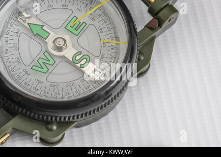 Macro-photo of compass rose face with needle. North direction. Outward Bound concept. - Stock Image