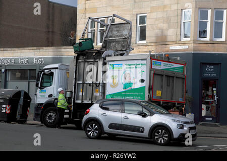 A green bin about to empty its contents into a bin lorry owned by Keenan Commercial Food Waste Collection Service - Stock Image