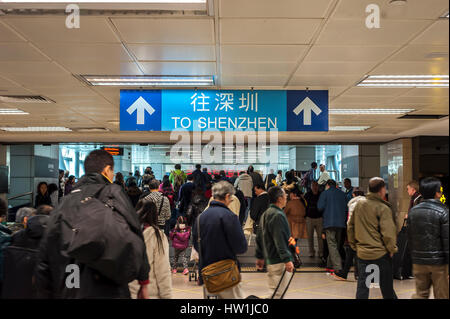 HONG KONG, CHINA - DEC 24, 2013 - Direction sign pointing towards Shenzhen at Lowu Station on the border between - Stock Image