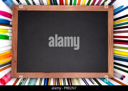 Back to school banner. Chalkboard with pencils on background, blank copy space at center - Stock Image