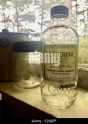 Old glass bottles including listerine mouth wash - Stock Image