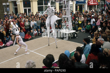 Street festival in Walthamstow London with entertainers walking on stilts - Stock Image