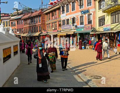 Pilgrams on the circuit around the Boudhanath Stupa, Kathmandu, Nepal - Stock Image