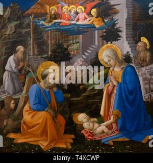 Adoration of the Christ Child with St. Joseph, St. Jerome, St. Hilarion, St. Mary Magdalen and Angels, Filippp Lippi, circa 1455, Galleria degli Uffiz - Stock Image
