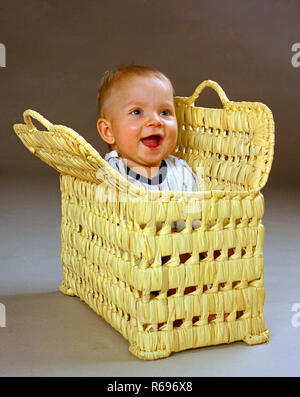 Small boy fits in basket - Stock Image