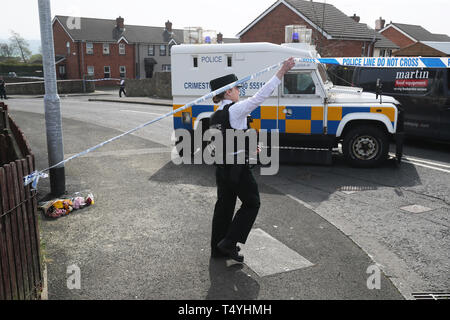 A police officer at the scene in Londonderry, Northern Ireland, where 29-year-old journalist Lyra McKee was shot and killed when guns were fired and petrol bombs were thrown in what police are treating as a 'terrorist incident'. - Stock Image