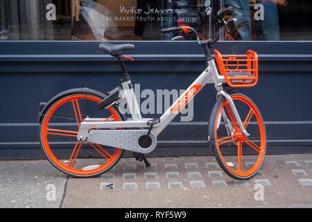 A Mobike electric bike or e-bike in Soho, London. - Stock Image