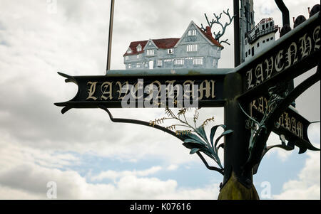 Ornate metal sign for Lavenham, Suffolk, UK, featuring the medieval houses for which the village is famous - Stock Image