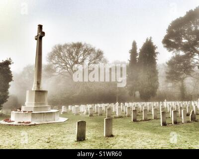Military Cemetery on a misty winter morning, Royal Victoria County Park, Netley, Hampshire, England, UK - Stock Image