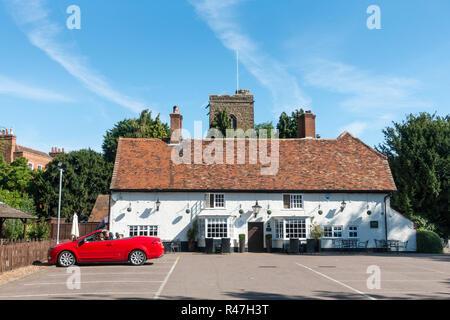 The Parish Church of Saint Mary Virgin and the Crown Pub, Northill, Biggleswade SG18 9AQ, UK - Stock Image