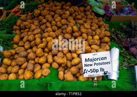 Majorcan new potatoes in a greengrocers market stall in North Yorkshire in March 2019 priced £1.50p per pound. - Stock Image
