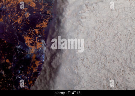 A pile of fluorine spar surrounded by fluorite stones. - Stock Image
