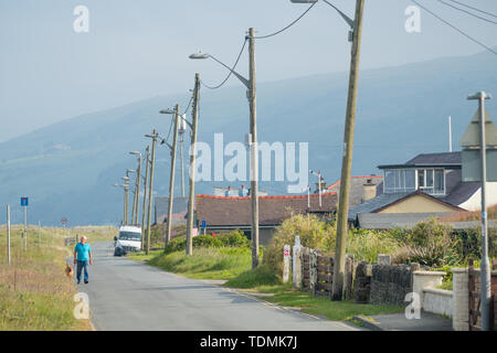 Fairbourne, Gwynedd , North Wales. The low-lying coastal  town is threatend by climate change and erosion by the sea,  and the decision by Gwynedd County Council not to allocate future resources to maintain the sea defences protecting the homes and properties on the Cardigan Bay coast. The inhabitants of the town may become the UK's frst 'climate change refugees' as their properties become unsellable and are abandoned to the sea under a policy of 'managed retreat' - Stock Image