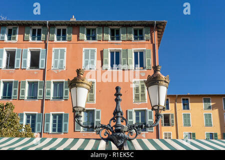 typical facades at flower market, Vielle Ville, old city center of Nice, French riviera - Stock Image