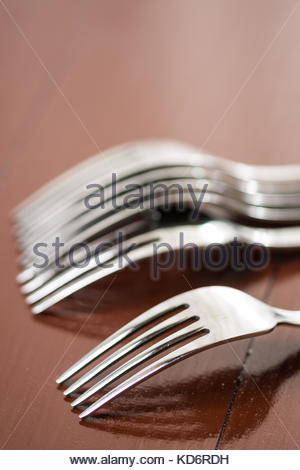Selective focus on the metal fork with blurred background. - Stock Image