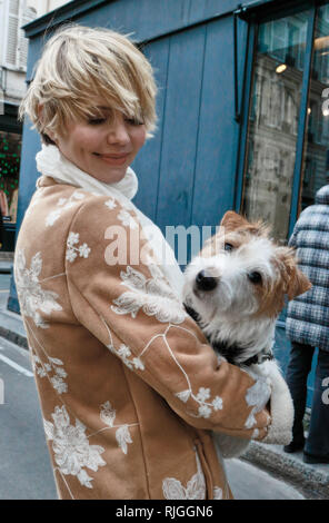 Woman hugging dog in the street. Paris. France - Stock Image