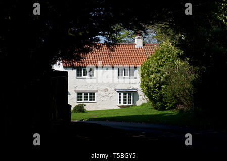 House in the village of Thwing, East Yorkshire, England UK - Stock Image