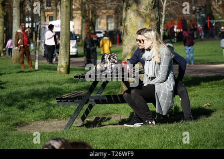 Glasgow, UK, 30th March 2019 : A sunny and warm Saturday in Glasgow seen many residents of Glasgow enjoy the greenery of Queens Park. Credit: Pawel Pietraszewski / Alamy Live News - Stock Image