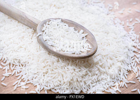 A Wooden Kitchen Spoon On A Pile Of Rice - Stock Image