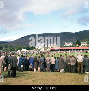 1960s, Scottish highlands, spectators watching the Braemar Games. - Stock Image
