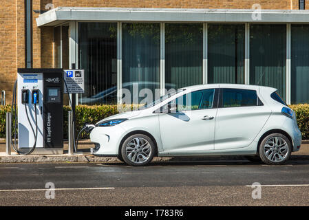 Electric car plugged into Evolt charge point in Cambridge, England, UK. - Stock Image