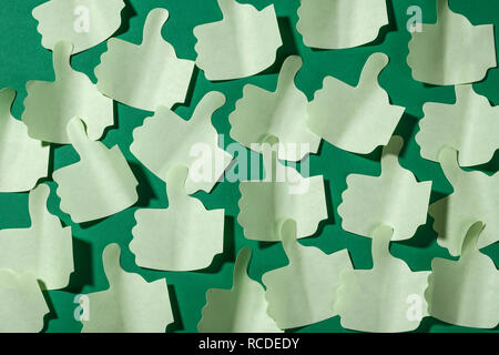 An abstract pattern of thumbs up paper sticky notes - Stock Image
