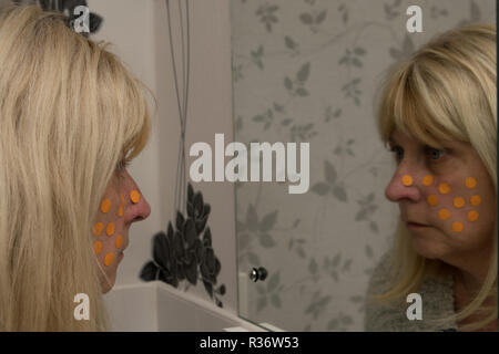 MR woman with polka dots on her face - Stock Image