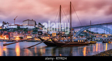 traditional Rabelo boats, Douro river, cityscape, panorama, twilight,  Porto, Portugal - Stock Image