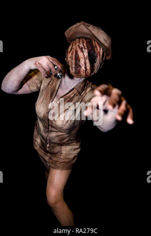A woman dressed as the zombie nurse from the computer video game 'Silent Hill' at a Comicon convention. - Stock Image
