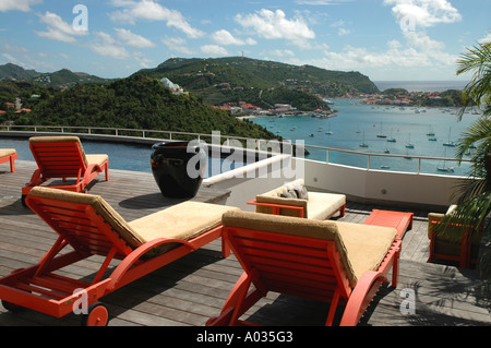 Saint Barth St Barts Private rental Villa Pool lounge chairs overlooks Gustavia Harbor Caribbean sea - Stock Image