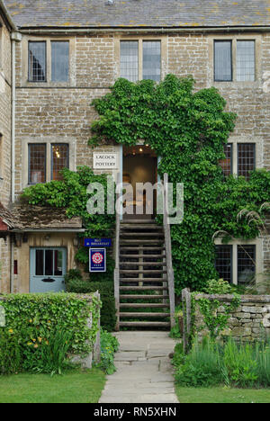 Steep wooden steps leading to the Pottery in the historic village of Lacock, UK; the building was formerly a Victorian workhouse. - Stock Image