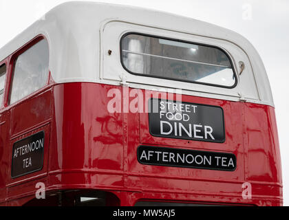 Rear closeup of a double-decker London bus converted to to a street food diner at the Albert Dock Liverpool May 2018 - Stock Image