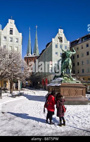 Nicolaiviertel in winter , St Georg dragon statue, Nikolai church, snow, Berlin , Germany - Stock Image