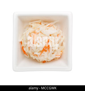Coleslaw salad in a square bowl isolated on white background - Stock Image
