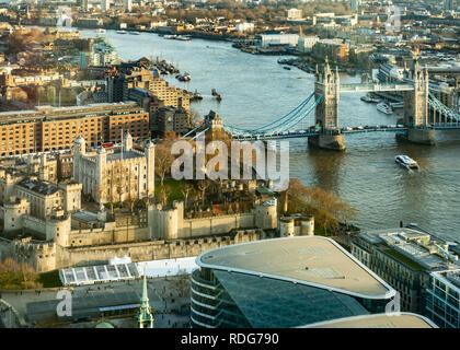 Elevated view of part of London, England overlooking the Tower of London, the River Thames and Tower Bridge as well as many other buildings on both si - Stock Image
