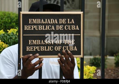 Worker installing sign New Cuban embassy Washington D C - Stock Image