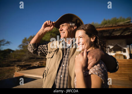 Couple looking at view during safari vacation - Stock Image
