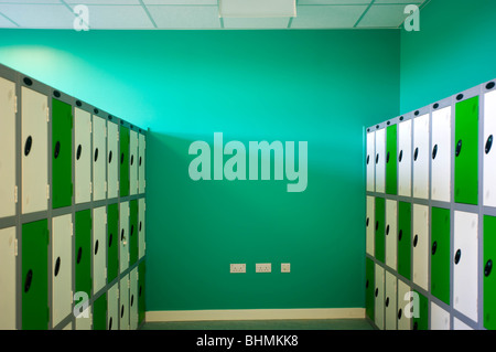image of changing room with green and white lockers - Stock Image