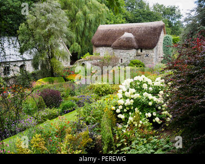 August view over the lower terrace of the walled garden at The Garden House, Buckland Monachorum, Devon, UK - Stock Image