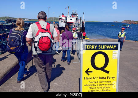 Passengers queuing on the slipway at Fionnphort, Isle of Mull,  for the CalMac ferry to Iona - Stock Image