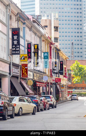 Parked vehicles in Liang Seah Street  and adverting billboards for the restaurants in the street, Singapore. - Stock Image