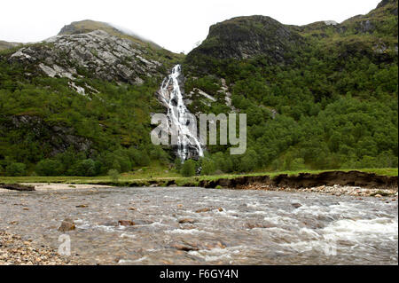 The majestic waterfalls at Steall tumbling into the water of Nevis deep in Glen Nevis - Stock Image