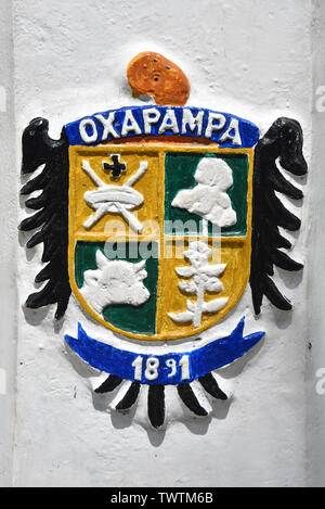 Oxapampa, Peru - Dec 31, 2018: The Oxapampa coat of arms painted on a lamp post in the Plaza de Armas - Stock Image